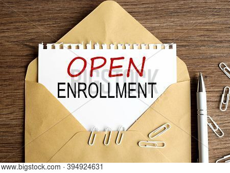 Open Enrollment, Text On White Paper On Wood Background