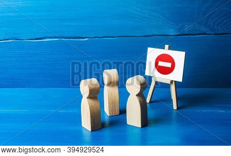People Look At The Easel With No Stop Entry Symbol. Prohibition Of Actions And Operations, Restricte