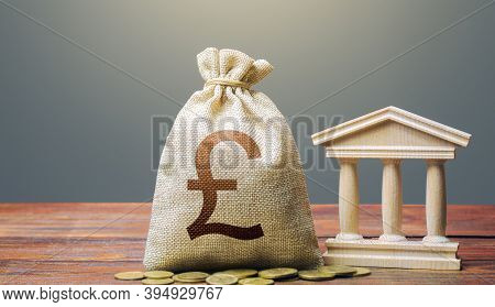 British Pound Sterling Money Bag And Bank / Government Building. Tax Collection And Budgeting. Monet