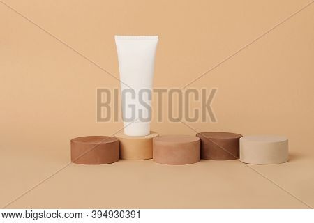 Empty Cosmetic Tube Standing On The Geometrical Podiums.beautiful Earth Colors.concept Of The Tonal