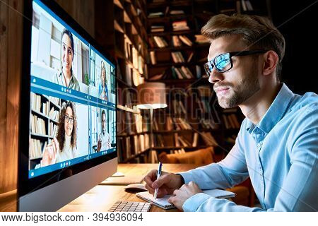Business Man Having Virtual Team Meeting On Video Conference Call Using Computer. Social Distance Em