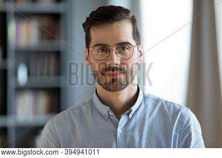Headshot Portrait Businessman Standing In Modern Office Pose For Camera