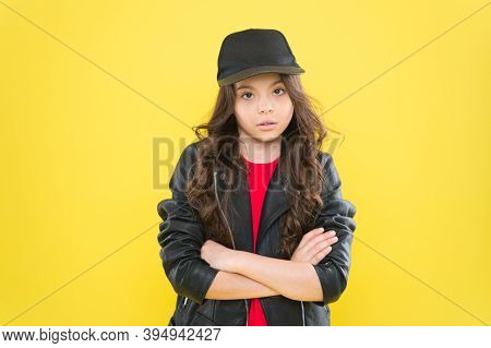 Casual Look. Little Kid Keep Arms Crossed Yellow Background. Wearing Casual Style. Trendy Childrens