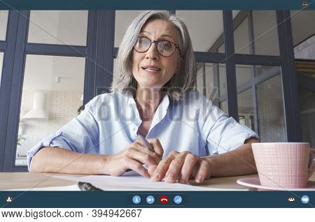 Senior Older Middle Aged Business Woman Teacher, Remote Tutor, Distance Coach Talking To Camera At V