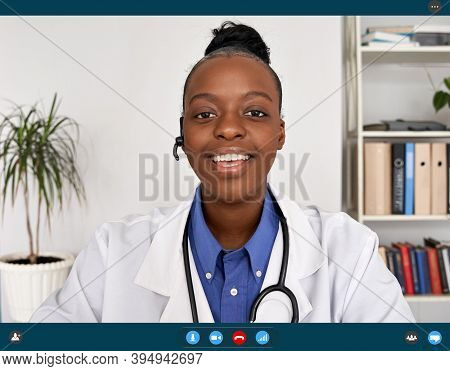 African Female Doctor Talking To Web Cam Consulting Patient In Virtual Telemedicine Chat Online Tele