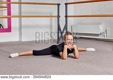 Cute Guy In Twine At Ballet School Smiles And Looks At The Camera.