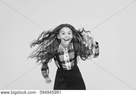 Air In Her Hair. Natural Beauty. Girl Kid Long Hair Flying In Air. Child With Natural Beautiful Heal