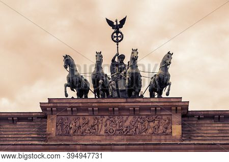 Brandenburg Gate, Germany, Berlin. Against The Blue Sky