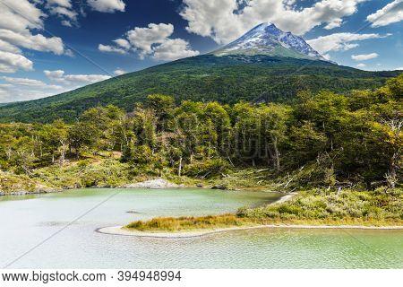 Cerro Guanaco mountain seen from the Black Laggon (Laguna negra) in Tierra del Fuego National Park, Argentina