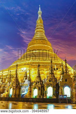 Shwedagon is the most sacred golden buddhist pagoda in Myanmar. Yangon, Myanmar. Sunset photo