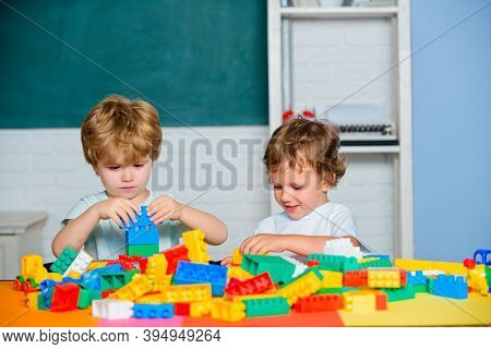 Cheerful Smiling Little Pupil Having Fun Against Blackboard. Concept Of Education And Reading. Kid S