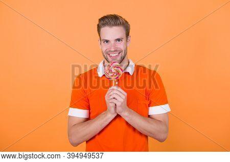 Symbol Of Happiness. Man Eat Sweet Lollipop. Man Smiling Hold Lollipop. Cheat Meal Concept. Sugar Ha