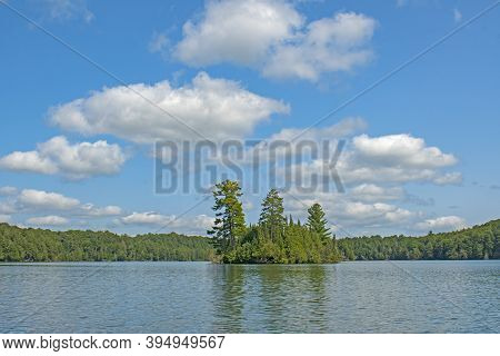 High Skies And Puffy Clouds In The North Woods On Mountain Lake In The North Woods In The Sylvania W