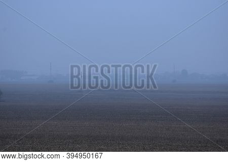 Autumn Landscape Of The Vast Fields Of Vojvodina, With Fog In The Background