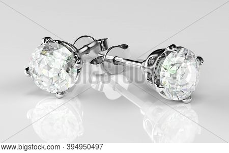 Earrings With Diamond On A White Background. Jewelry For Women. 3d Rendering