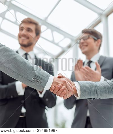 close up. business people, confidently shaking hands.