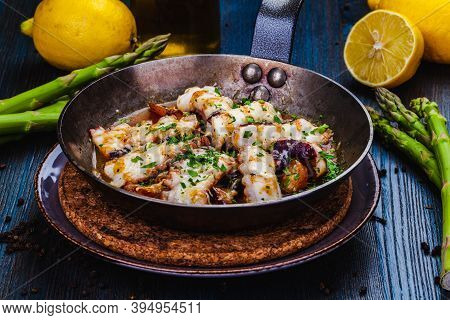 Pan Seared Octopus With Roasted Potato.close Up