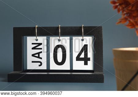 January 4, Date Design With A Black Wooden Calendar For A Business, Date Plans To Remind.