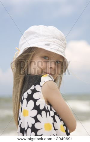 Cheerful Girl In Beautiful Dress And Hat