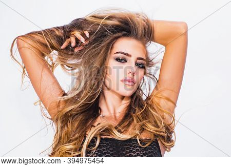 High Fashion Model Woman Posing In Studio. Beauty Face Of The Young Beautiful Woman - Isolated On Wh