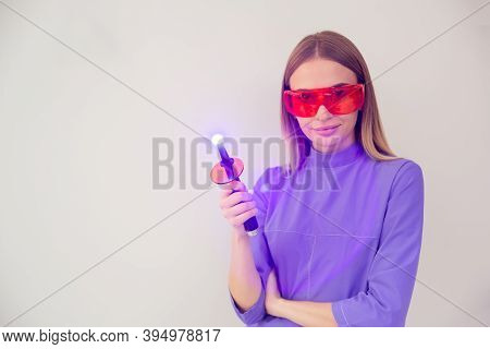 Dentist With Glasses And A Tool In His Hands