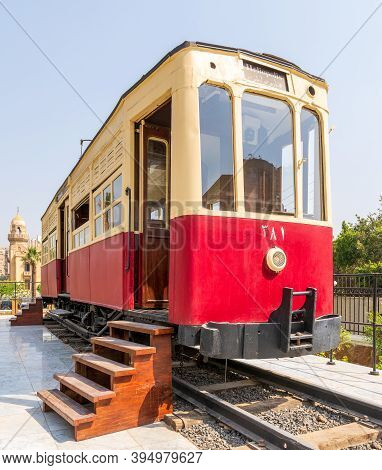 Cairo, Egypt- July 29 2020: 1953 Vintage Old Tram With Wooden Stairs, Displayed In Front Of Baron Em