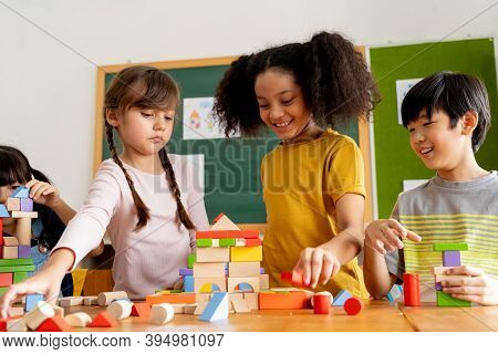 Group Of Multiethnic School Friends Using Toy Blocks In Classroom, Education, Learning, Teamwork. Ch