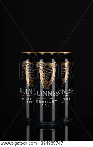 Prague,czech Republic - 12 November,2020:guinness Cans On The Black Background.guinness Is A Dark Ir