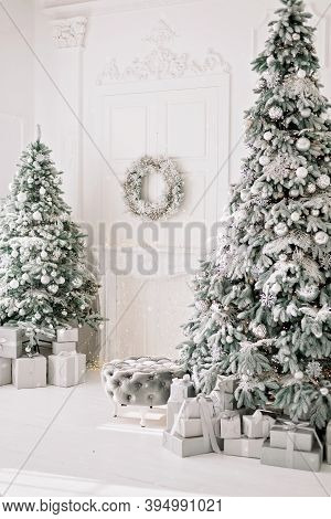 Festive Interior. Luxurious Christmas Tree Decorated With Lights With Gifts. Happy New Year 2021. Ch