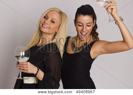 Two beautiful elegant party girls on white isolated background