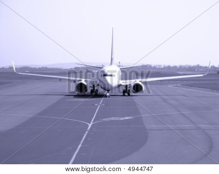 Passenger Jet Taxiing On Airport Runway