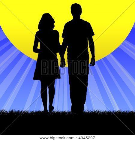 Couple Walking Into Sun