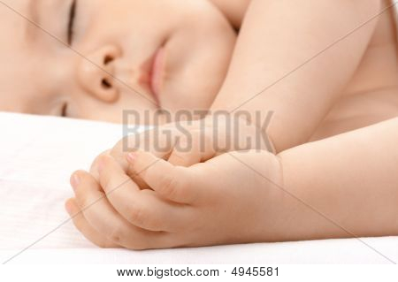 Caucasian Child Asleep, Clasping Hands Together