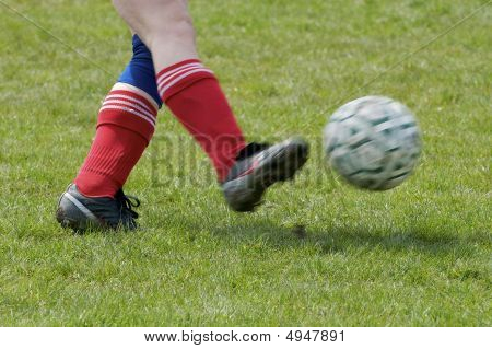 Feet Kicking Soccer Ball
