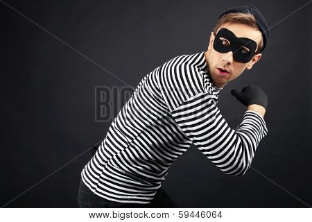 Thief isolated on black poster