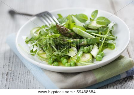 fresh green salad with asparagus,rocket,peas,spring onions,zucchini and basil.. sprinkled with olives oil and lemon