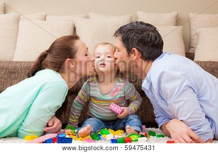 playful family with child at home