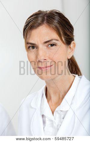 Portrait of confident female scientist in laboratory