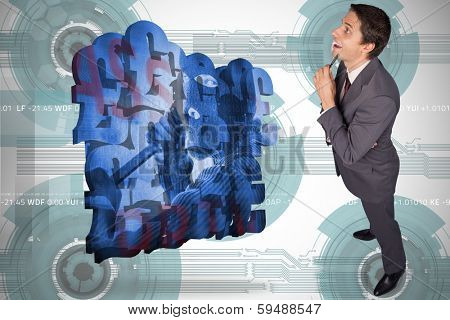 Thinking businessman holding pen against technology wheel background