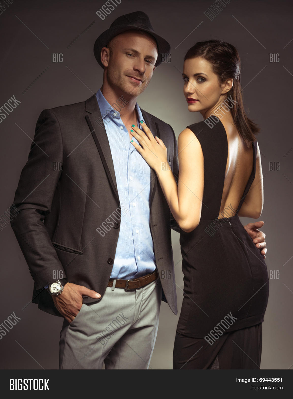 e4035753639 Attractive sexy couple in trendy evening wear on a romantic night out  standing in an intimate