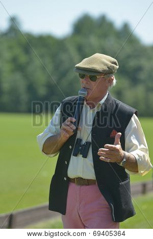 TSELEEVO, MOSCOW REGION, RUSSIA - JULY 26, 2014: Voice of British Polo Day Lt. Colonel Simon Ledger comments the match. It was the second British Polo Day in Russia