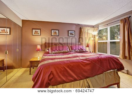 Bedroom Interior With Beautiful Bed In Red And Mocha