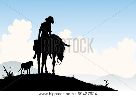 Illustrated silhouette of a weary traveler riding his donkey with dog following
