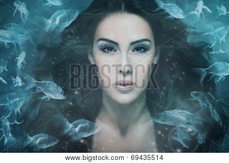 surreal mermaid woman portrait surrounded by fishes, composite photo