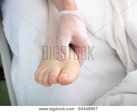 Doctor Examines Foot Of Patient