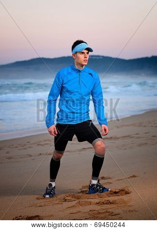 Athlete Standing On The Beach