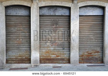 Lowered Rolling Shutters Of A Disused Shop