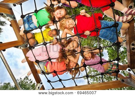 Children look though gridlines of playground