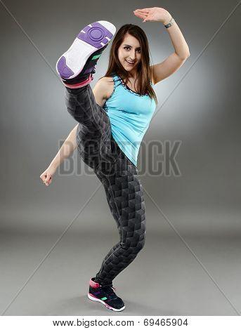 Woman Executing A High Kick