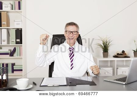 Jubilant Doctor Sitting Cheering In His Office